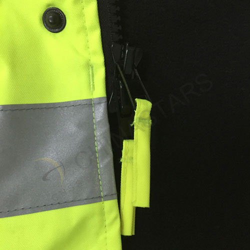 Reflective jacket with detachable cuffs.