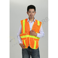 Fluorescent orange reflective vest with prismatic tape