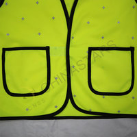 Children safety vest with reflective dot pattern