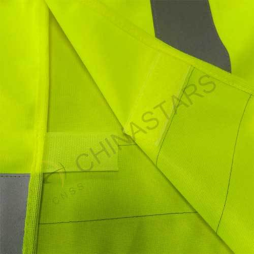 Reflective safety vest with cross reflective tape