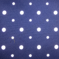 Dot pattern reflective fabric for outdoor clothing