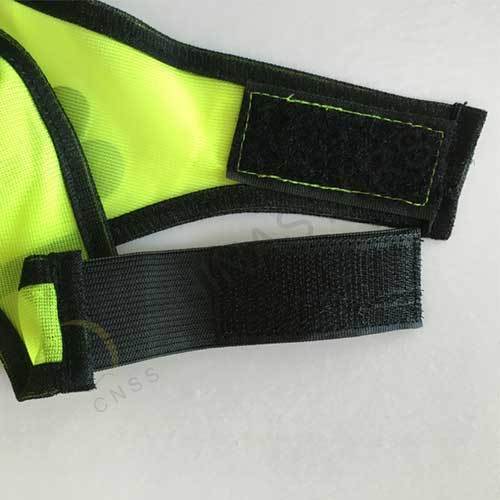 Dog safety vest with reflective bones pattern