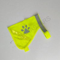 Pet safety vest with paw pattern and reflective tape