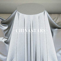 Perforated reflective stretch fabric for fashion clothing