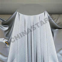 Perforated reflective fabric for outdoor clothing