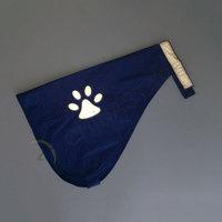 Navy blue dog safety vest with paw pattern
