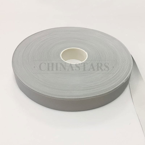 Single sided reflective spandex fabric for binding tape