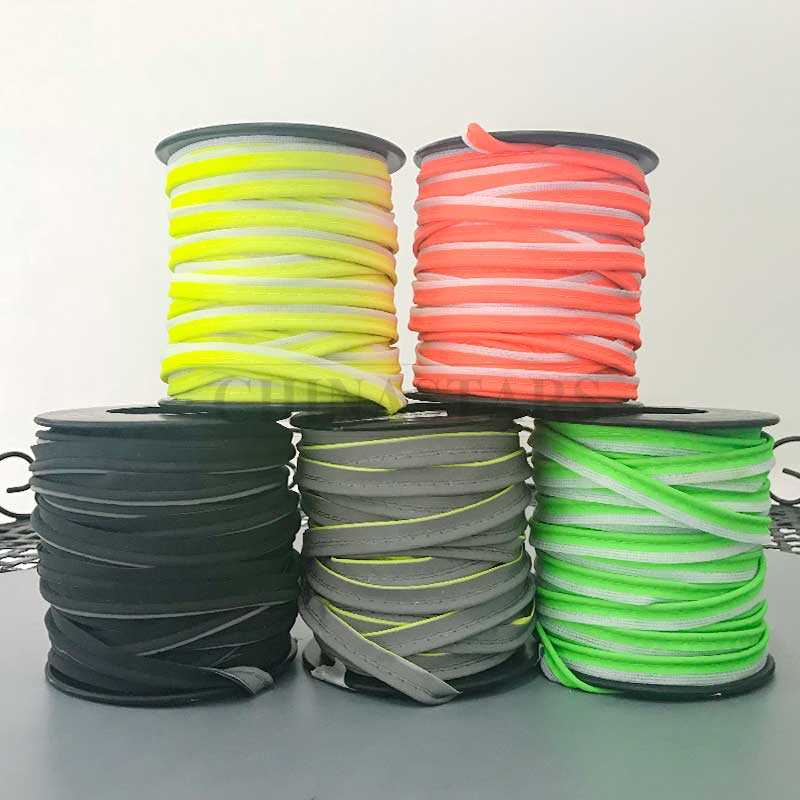Colored reflective piping and binding tape