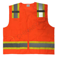 Orange reflective safety vest with warning tape