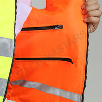 Reversible, double colored reflective safety vest