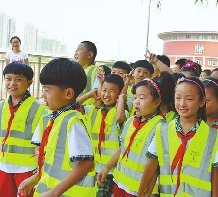 Walk home safety with a reflective vest after night school study
