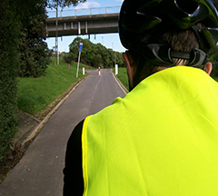 Cycling to office in reflective safety vest