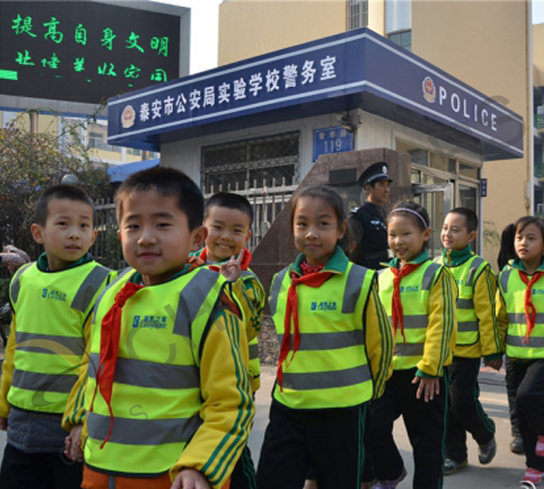 Junior high school students wear reflective vests