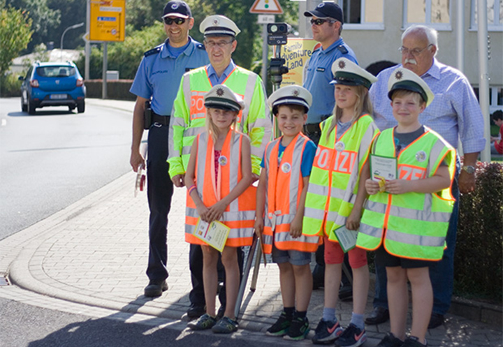 Children in safety vest to learn the traffic laws