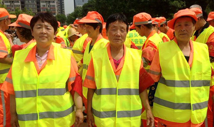 Child buy reflective vest for sanitation workers