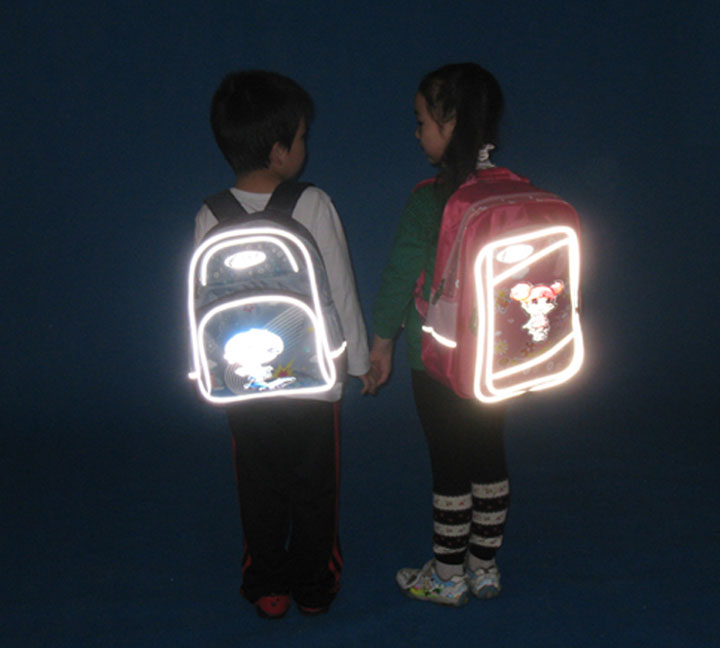 Reflective tape on school bag more secure