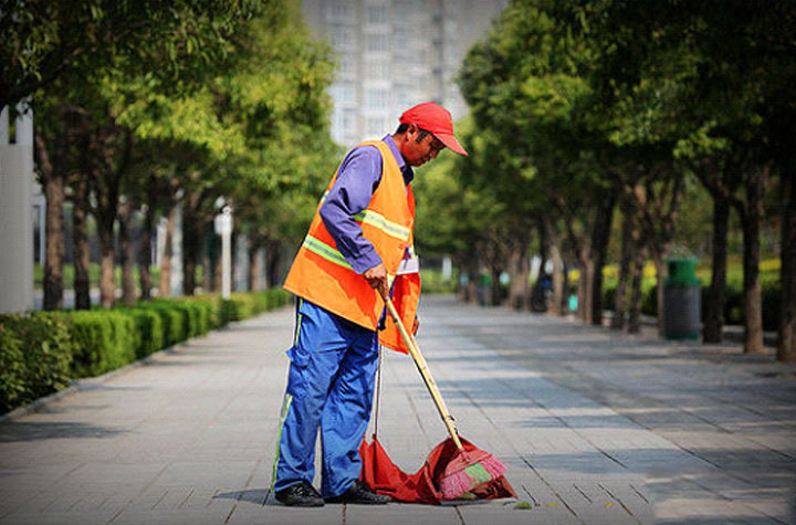 Why the sanitation workers have to wear reflective vests